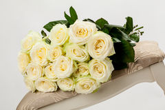 Bouquet of beautiful tea-roses on a banquette Stock Images