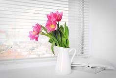 Bouquet of beautiful tulip flower. S on windowsill Royalty Free Stock Photography