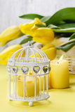 Bouquet of beautiful yellow tulips and candle Stock Images