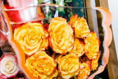 Bouquet of big yellow with red roses royalty free stock photo