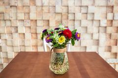 Bouquet of blossom flowers. On the table Royalty Free Stock Photo