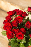 Bouquet of blossoming dark red roses Stock Photos