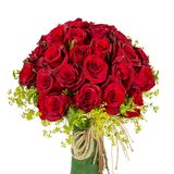 Bouquet of blossoming dark red roses in vase isolated on white background Royalty Free Stock Photos