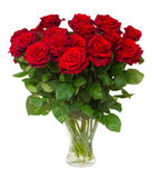 Bouquet of blossoming dark red roses in vase stock photo