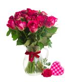Bouquet of blossoming dark red roses in vase royalty free stock images