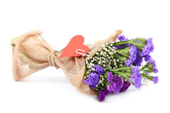 Bouquet of blue flowers and red heart. Royalty Free Stock Photos