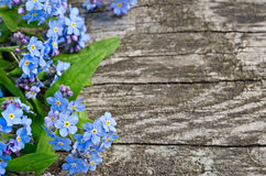 Bouquet of blue forget-me on a wooden background Royalty Free Stock Photography
