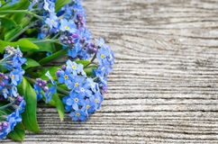 Bouquet of blue forget-me on a wooden background Stock Photography