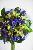 Bouquet of blue irises with Salal and painted willow. Close Royalty Free Stock Photos