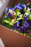 Bouquet of blue irises with Salal and painted willow. Close Royalty Free Stock Image