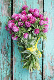 Bouquet on the boards. Beautiful bouquet of wild flowers clover royalty free stock photography