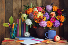 Bouquet and book. September 1 Teacher's Day. Royalty Free Stock Images