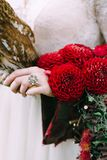 Bouquet with bordeaux dahlias on bride hand. Vintage ring. Wedding decoration. Royalty Free Stock Images
