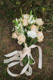 Bouquet of bridal wedding flowers. On ground in wood. Rustic style of elements of decor. Top view vertical color photo Royalty Free Stock Photo