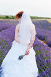 Bouquet of the bride against the background of dress Stock Photography