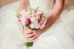 Bouquet. Bride in a beautiful dress holding a bouquet Stock Photo