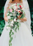 Bouquet. Bride with a bouquet of flowers in their hands Royalty Free Stock Images