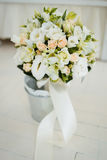 Bouquet of the bride in a bucket Stock Photo