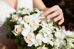 Bouquet with bride hand Stock Photo