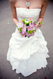 Bouquet in bride's hands Royalty Free Stock Image