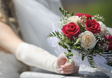 Bouquet in brides hand Royalty Free Stock Image