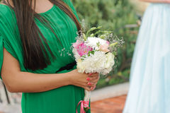 Bouquet in Bridesmaid's Hands Royalty Free Stock Image