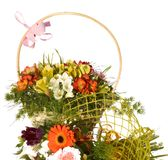 Bouquet of bright flowers in basket isolated on white Royalty Free Stock Photos