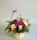 Bouquet of bright flowers in basket Stock Photo