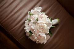 Bouquet on brown leather chair royalty free stock images