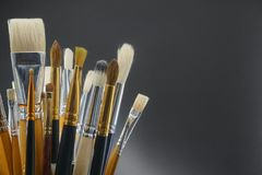 Bouquet of brushes for drawing on a black background stock photos