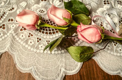 Bouquet from buds of pink roses with lace tablecloth Royalty Free Stock Photography