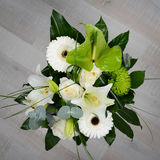 Bouquet bunch of beautiful white flowers with white roses, lily and daisy Royalty Free Stock Image
