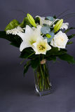 Bouquet bunch of beautiful white flowers with white roses, lily and daisy Royalty Free Stock Images