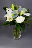 Bouquet bunch of beautiful white flowers with white roses, lily and daisy Stock Image