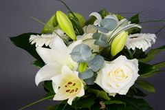 Bouquet bunch of beautiful white flowers with white roses, lily and daisy Royalty Free Stock Photo