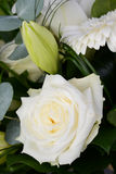 Bouquet bunch of beautiful white flowers with white roses, lily and daisy Royalty Free Stock Photos