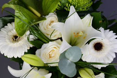 Bouquet bunch of beautiful white flowers with white roses, lily and daisy Stock Photo