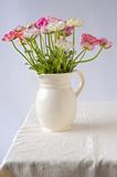 Bouquet of buttercups. Bouquet of buttercup flowers in a ceramic pitcher Royalty Free Stock Image