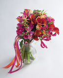 Bouquet of calla lilias and roses Royalty Free Stock Image