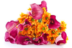 Bouquet of calla lilies and orange chrysanthemums Stock Image