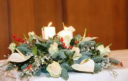 Bouquet with calla lilies, white flowers and Holly on the white Royalty Free Stock Photography