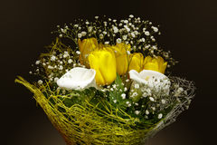 Bouquet of calla lilies and yellow tulips Royalty Free Stock Photos