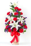 Bouquet of canation and lily. In a vase Stock Photo
