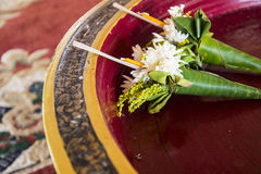 Bouquet with candle and joss stick. For paying respect to buddha Royalty Free Stock Photography