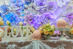Bouquet, candles and flowers. On the table Royalty Free Stock Image