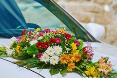 Bouquet on the Car Bonnet royalty free stock photography