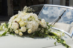 Bouquet in a car. Wedding car with white flowers Stock Photo