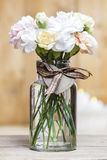 Bouquet of carnation flowers in glass vase Stock Images