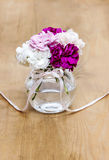 Bouquet of carnation flowers in glass vase Royalty Free Stock Image