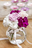 Bouquet of carnation flowers in glass vase Stock Image